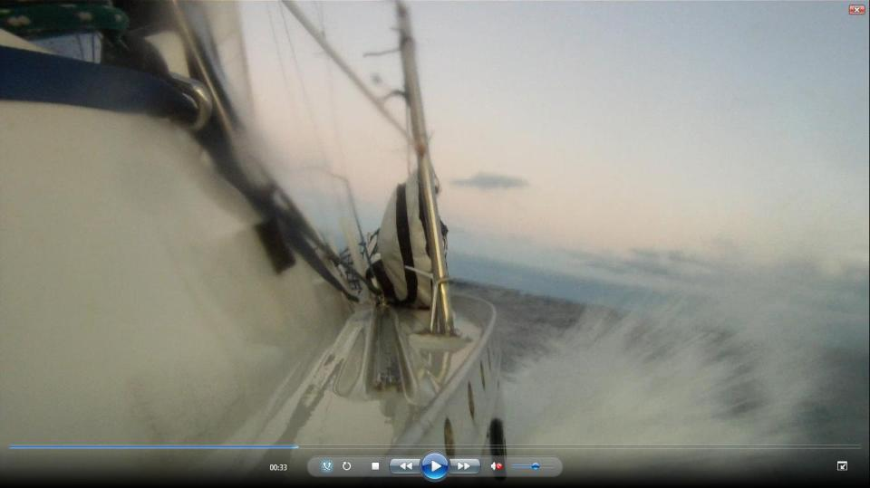 A screen capture from video I shot while sailing back to the United States from Bermuda.  I was holding the tiny GoPro camera while steering my boat as the sun was setting in the West a few hundred miles off the coast.